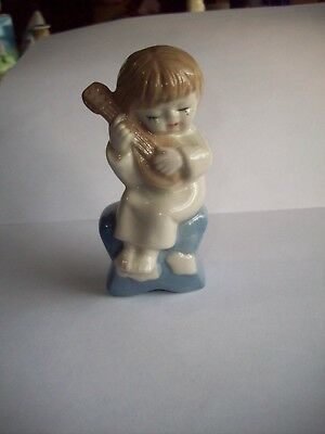 Vintage Cute Little Figurine Boy sitting on star Playing Music