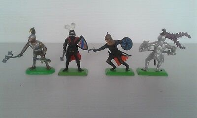 4 Vintage  Britains Deetail  Knights. All with weapons.