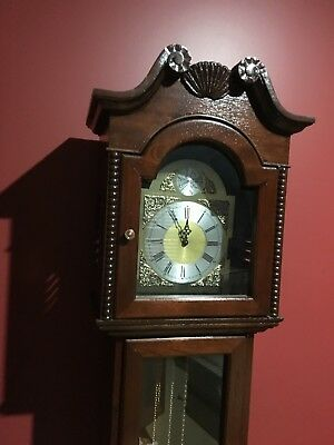 A beautiful grandfather clock, in exceptional condition and quality finish.