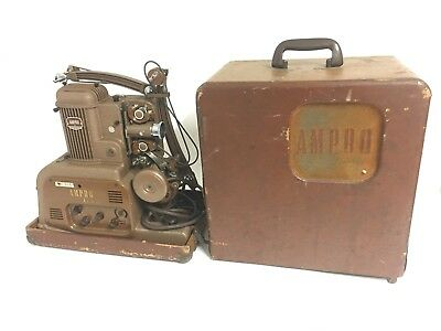 VINTAGE AMPRO STYLIST 16mm MOVIE PROJECTOR & CASE WITH BUILT-IN SPEAKER