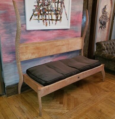 Dialogica custom made carved wood bench