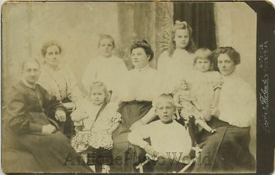 Family with children & large doll antique cabinet photo