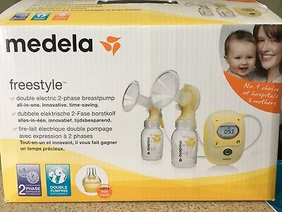 Medela Freestyle double electric 2-phase breastpump (as NEW!) + EXTRAS!
