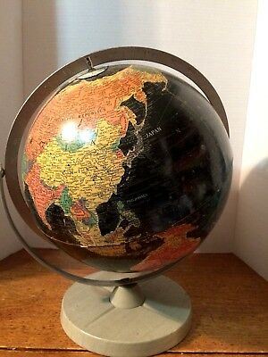 Lovely aged world globe on its rotating spinner, made in USA