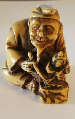 Vintage Netsuke Sitting Man With Small Statue