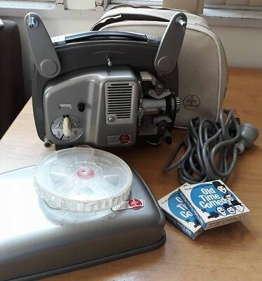 Bolex 18-5 Projector in case with bonus movies. Great working condition.