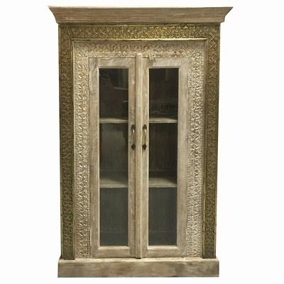 Simple White Washed Cabinet With Intricately Carved Wood Panels And Brass Detail