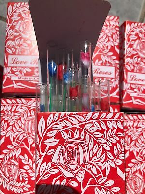"8 Boxes of 36 Total 288 Tiny silk Love Roses in 4"" Glass Tubes."
