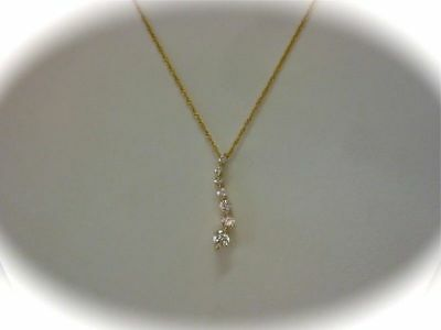 Charles And Colvard Yellow Gold Moissanite Wave Pendant…..aj