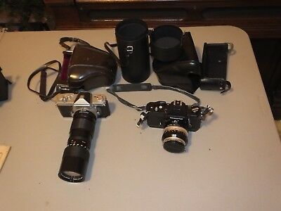 Two Nikon Nikkormat cameras a black FT3 and a FT w/ 2 lenses