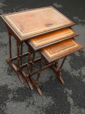 Classic vintage Regency style mahogany nest of tables, gold tooled leather tops