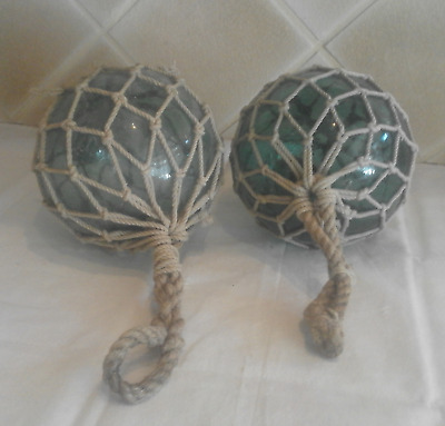 """Pair Blueish/Green Glass Fishing Netted Floats Marked """"F"""" 17.25 in Circumference"""