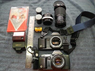 2 Vintage Cannon T-70 With Accesories