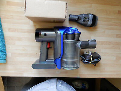 Dyson DC 31 with NEW BATTERY, tools , wall mount & charger, POST FREE
