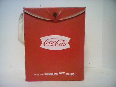 antique coca cola box like cooler with white strap