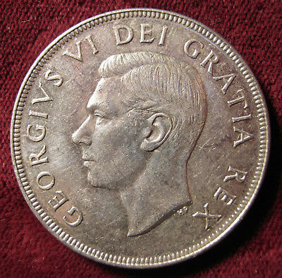 1952 Canadian Dollar. Uncirculated, Full Water Lines. .800 Silver
