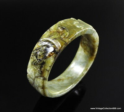 Chinese Celadon Nephrite Jade bangle Brown and green Qing Dynasty carved