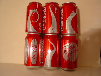 24 Misc. Coke Cans  Bottom Opened!