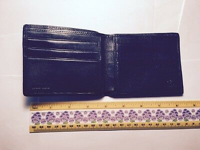 Calvin klein Leather wallet 4 1/3 by 3 1/3 inches Genuine Excellent condition