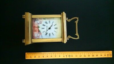 French carriage clock. Case in brass with glass and enamelled side panels