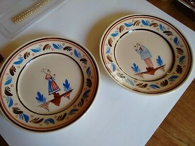 pair of folk art cream colored French plates