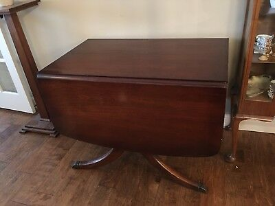 Duncan Phyfe mahogany drop leaf table, 4  10 Inch leaves and padded toppers
