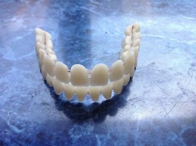 teeth complete set  2 Arch acrylic with metal strengthner  shade A2