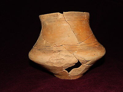 Ancient pottery shards (cup 125 mm). Trypillian culture. Ukrainian artifacts.