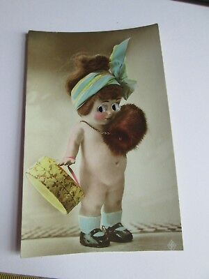 Glass Eyed Novelty postcard of Part dressed Doll c1915-1930 (unposted)