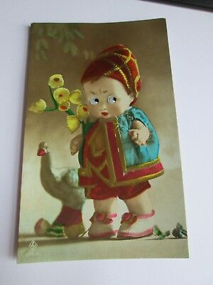 Glass Eyed Novelty postcard of child/doll c1915-1930 (unposted)