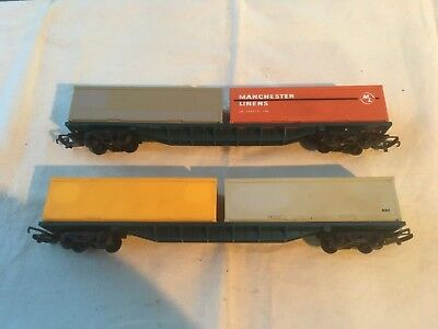 2 Hornby Flat wagons with containers in OO scale.