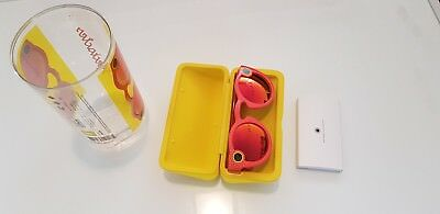 Orange Snapchat Spectacles opened for inspection, never used
