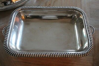 Silver plated serving dish. Rectangular with decorative feet. Good condition.