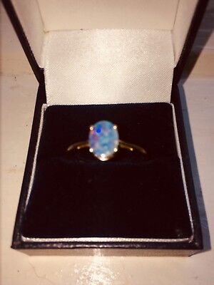 boulder opal 9 k gold ring beautiful colour play