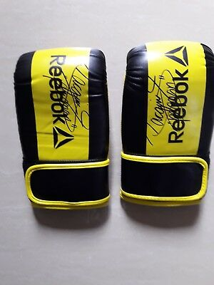 Two Yellow / Black Reebok original Boxing gloves hand signed by Manny Pacquiao