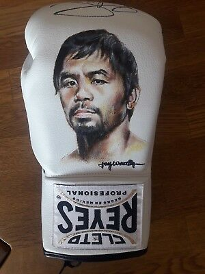 Hand painted White Cleto Reyes glove by Jay Connolly, signed by Manny Pacquiao