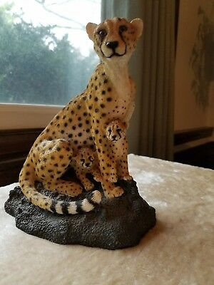 Cheetah mom and cubs statue