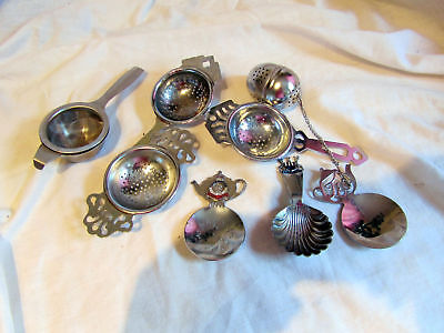 A Collection Of Vintage Tea Strainers, Brewers And Caddy Spoons