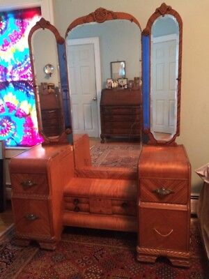 Art deco waterfall vanity with a unique blue square mirror
