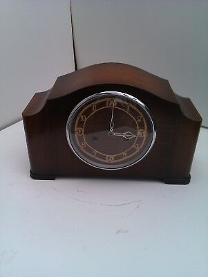 An Old Chiming Mantle Clock In Full Working Order