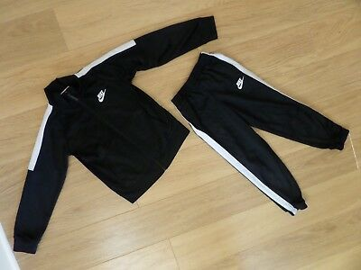 Boy's Nike Tracksuit. Age 5 - 6 Years.