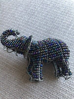 Multi-colored beaded wire elephant sculpture, raised trunk