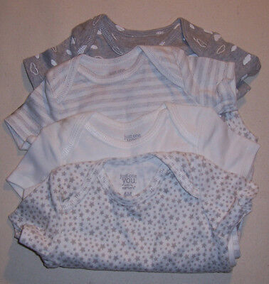 4 NEW Baby Bodysuits by Carter's Size 6 months (needs washing, has dirt smudges)