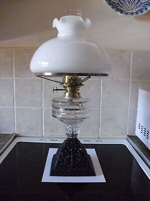 old cast iron and glass oil lamp  ,chimney and shade