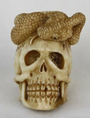 Hand Carved Cow Bone Skull with Snake