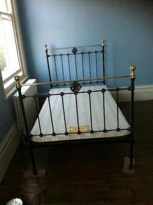 Antique single brass bed with base