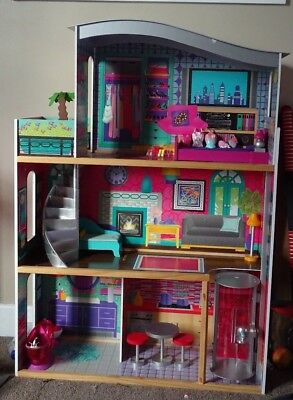 Doll house...free furniture and dolls clothes... great condition!
