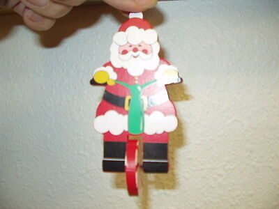 NIP Avon Gift Collection Santa On the Go Movable Ornament  Unicycle