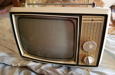 """VINTAGE GENERAL ELECTRIC GE TV screen 8"""" across PORTABLE white 1970s turns on"""