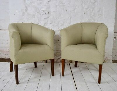 A pair of early 20th century tub chairs